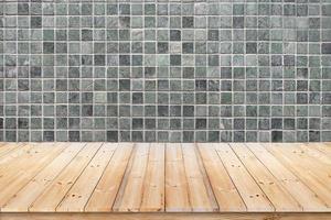 Green mosaic wall and wood floor. photo