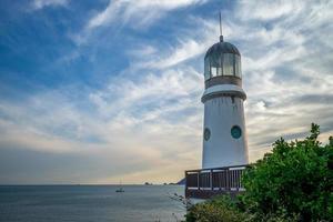 Lighthouse at Haeundae Dongbaekseom Island at Busan in South Korea photo