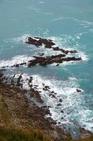 Rocks in the sea in the coast photo