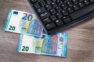 20 euro bills and computer keyboard photo