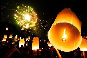 Floating lamp in yee peng festival on loy krathong day, Firework Festival photo