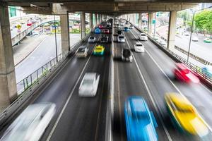 Motion blur of car on the road in the city photo