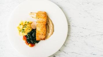Grilled salmon meat fillet steak with vegetable and sauce photo