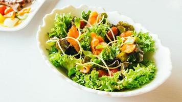 Smoked salmon with vegetable salad photo