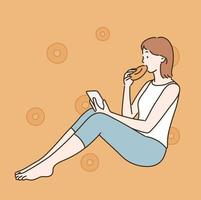 A girl is eating a donut while looking at her phone. hand drawn style vector design illustrations.