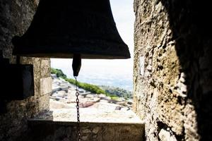 Silhouette of a bell in Erice, Trapani, Sicily, Italy photo