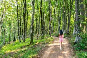 Young woman walking in Sataplia nature reserve photo