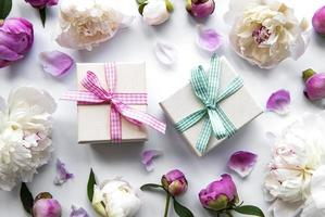 Peony flowers and gift boxes photo