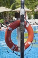 Playa del Carmen, Mexico, 2021 - Orange lifebuoy by the pool photo