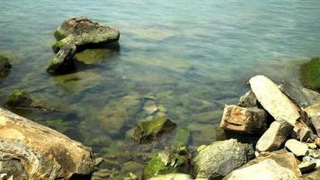 Large stones in the water, time-lapse video