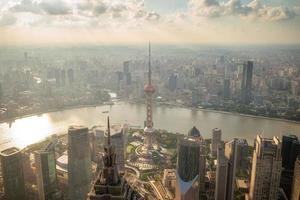 Skyline of Shanghai city by the sunset in China photo