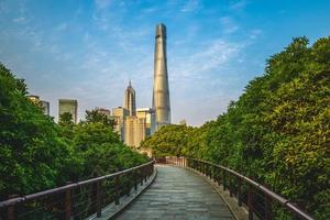 Skyline of Shanghai city and a wooden pathway, China photo