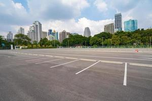 Empty parking lot with city in the background and beautiful blue sky photo