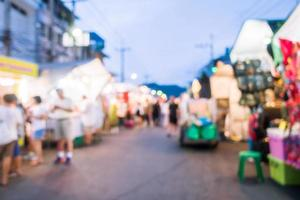Abstract blur and defocused night local market photo