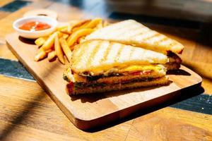 Club sandwich with french fries photo