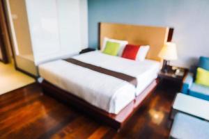Desenfoque abstracto e interior de dormitorio desenfocado foto