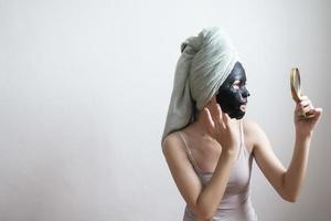 Beautiful woman with Black  facial mask, Lifestyle concept photo
