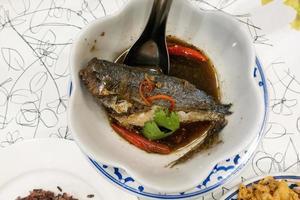 Boiled mackerel on dish photo