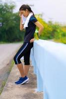 Portrait of beautiful girl in sportswear, running healthy fitness woman training for marathon outdoors photo