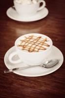 Hot caramel coffee cup latte photo