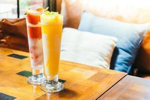 Ice drinking mango smoothie glass photo