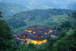 Aerial view of Tianluokeng Tulou cluster with mist, China photo