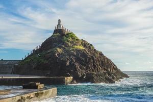 Old Lanyu lighthouse at Kaiyuan Harbor, Lanyu, Taiwan photo