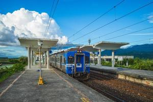 Train stop at Dongli railway station in Hualien, Taiwan photo