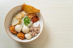 Spicy small flat rice noodles with fish balls and shrimp balls without soup - Asian food style photo