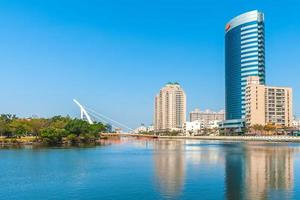 Tainan canal and skyline of city photo