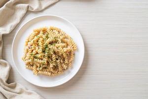 Spirali or spiral pasta mushroom cream sauce with parsley - Italian food style photo