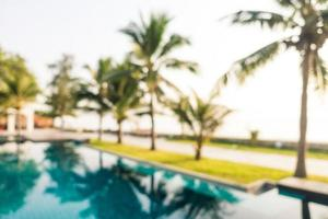 Abstract blur outdoor swimming pool with coconut palm tree photo