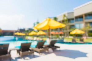 Abstract blur defocused swimming pool in luxury hotel resort photo