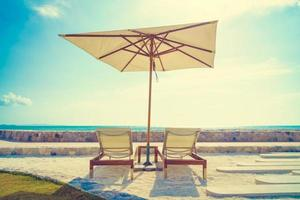 Umbrella and chair with sea view photo