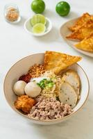 Spicy egg noodles with fish balls and shrimp balls without soup - Asian food style photo