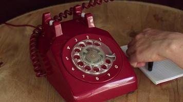 Answering an Old Vintage Red Phone And Taking Notes video
