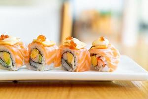 Salmon roll sushi with cheese on top - Japanese food style photo