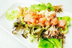 Raw tuna meat salad with spicy sauce photo