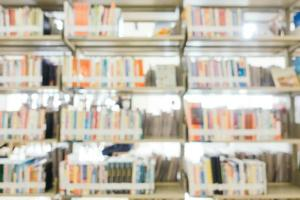 Abstract blur and defocused bookshelf in library photo
