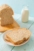 Sliced wholegrain bread on a wooden table photo