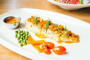 Grilled sea bass fish meat with sauce photo