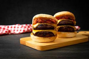 Hamburger or beef burgers with cheese and bacon - unhealthy food style photo