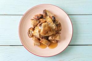 Grilled bananas with coconut caramel sauce on plate photo