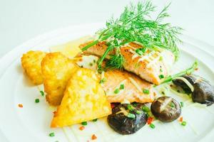 Grilled salmon meat fillet steak with vegetable photo