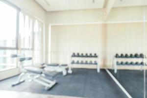Abstract blur fitness equipment in gym room interior photo