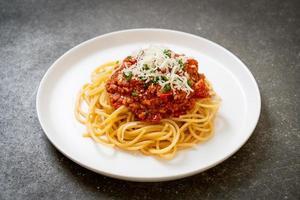 Spaghetti bolognese pork or spaghetti with minced pork tomato sauce - Italian food style photo