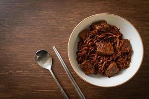 Jjapaguri or Chapaguri or Korean Black Beans Spicy Noodles with Beef photo