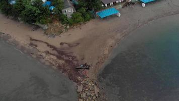 Flight over a rocky beach in the sea at dawn Aerial shot video