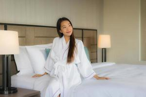 Portrait beautiful young asian women smile happy in bedroom photo