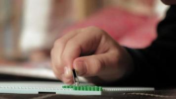A preschooler boy plays with peeler beads, close-up of his hands video
